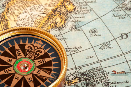 Old compass on vintage retro map Stock Photo - 28290547