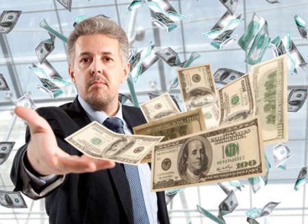 Handsome adult businessman throwing dollar Stock Photo