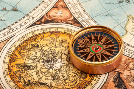 navigate: Old compass on vintage retro map
