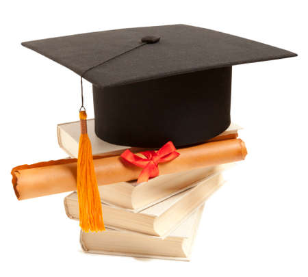 academic achievement: Graduation hat, book and diploma isolated on white