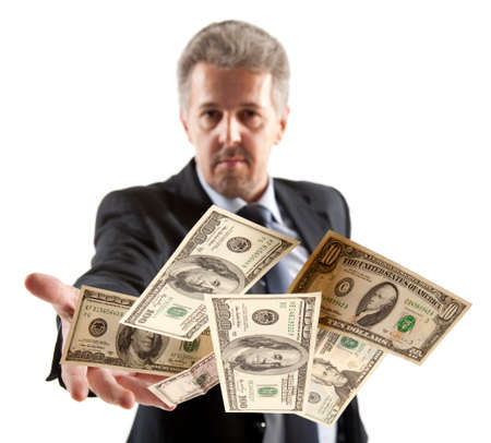 good investment: Handsome adult businessman throwing dollars Stock Photo