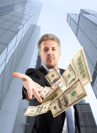 good investment: Handsome adult businessman throwing dollar Stock Photo