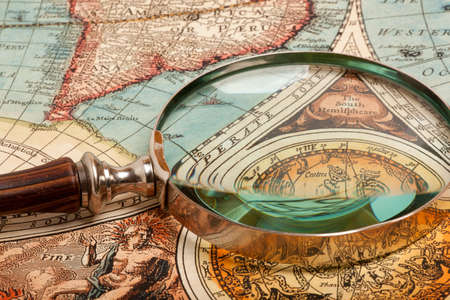 old document: Magnifying glass and ancient old map