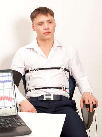 detector: A man passes a lie detector test