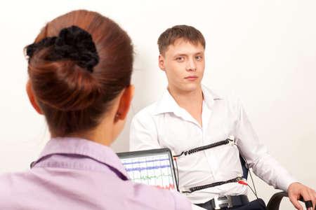 polygraph: A man passes a lie detector test