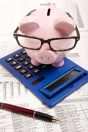 budget crisis: Pink piggy bank and calculator