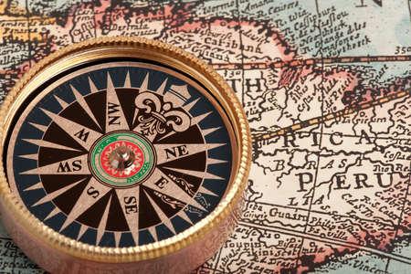bygone: Old compass on vintage retro map