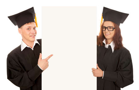 Two graduate students holding empty banner photo