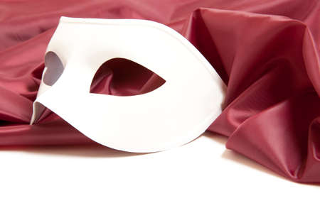 theater mask: White theatrical mask and silk fabric isolated a white background