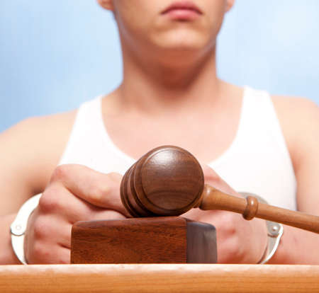 The arrest of the offender in the courtroom Stock Photo