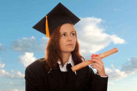 Beautiful woman graduating holding her diploma photo
