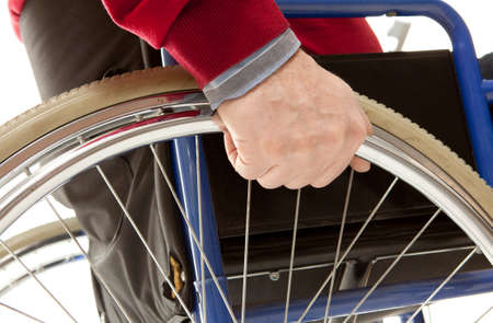 Wheelchair user makes various movements with his wheelchair, exercises for safety handling photo