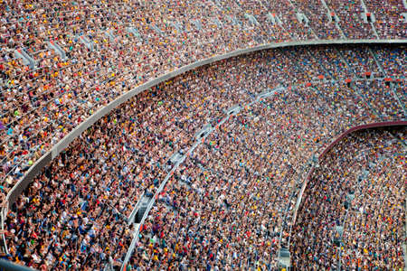 crowd of people: Fans at the big football stadium Stock Photo
