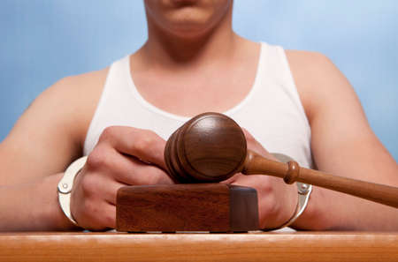 restraints: The arrest of the offender in the courtroom Stock Photo