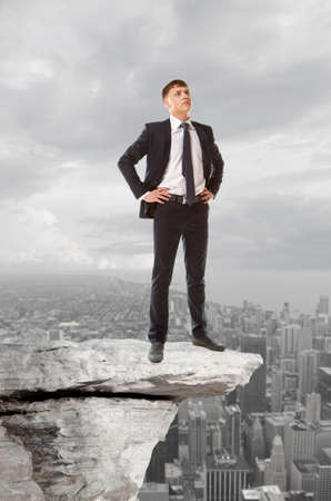 standing stones: Businessman standing on a peak  Business concept