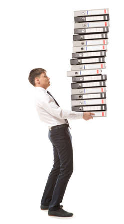 carries: Frustrated businessman looking at pile of file folders