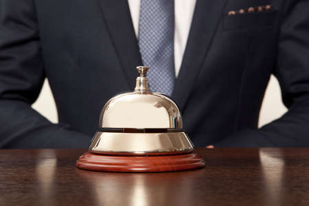 hospitality industry: Hotel Concierge. Service bell at the hotel