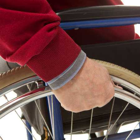 Wheelchair user makes various movements with his wheelchair, exercises for safety handling Reklamní fotografie