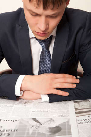 informing: Business man reading a newspaper, gray backgrounds