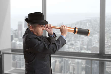 opportunity discovery: Business concept. Businessman looks through a telescope