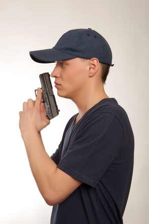 guardaespaldas: Hombre guardaespaldas aislado en un fondo gris Foto de archivo