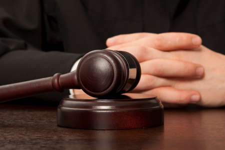 auction gavel: Judge. Referee hammer and a man in judicial robes Stock Photo