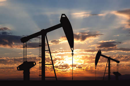 Oil pump oil rig energy industrial machine for petroleum in the sunset background