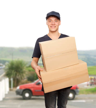 consign: Handsome young delivery man portrait