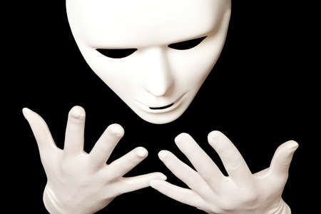 comedy tragedy: White theatrical mask isolated on black Stock Photo