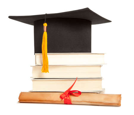 Graduation hat, book and diploma isolated on white photo