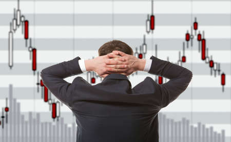 trader: Stock trader looking at monitors Stock Photo