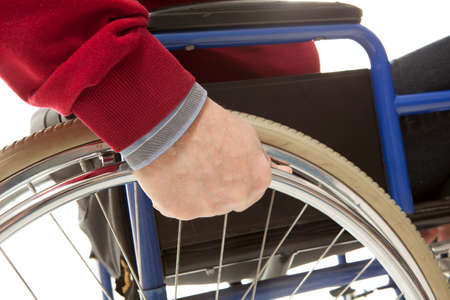 aplomb: Wheelchair user makes various movements with his wheelchair, exercises for safety handling Stock Photo