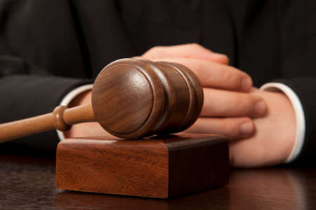 magistrate: Judge. Referee hammer and a man in judicial robes Stock Photo