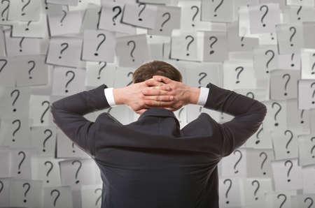 Brainstorming. Businessman solves complex problem photo