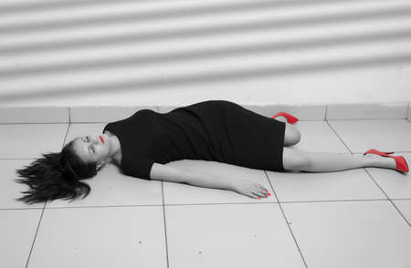 senseless: Crime scene imitation. Lifeless business woman lying on the floor