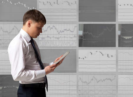 stock trader: Stock trader looking at tablet computer in office