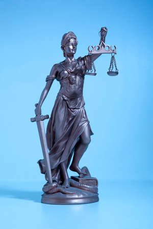 antique woman: Symbol Justice.  Lady of Justice. Blue Light Stock Photo