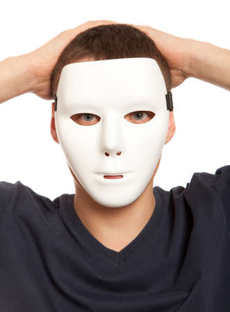 two faced: Man covering his face with white mask