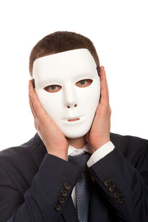 two faced: Businessman covering his face with white mask