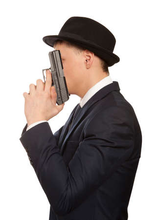criminal activity: Despair man with gun, crime isolated against white background Stock Photo