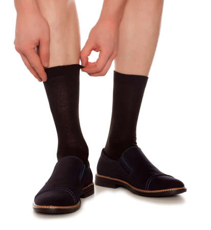 men socks: Legs from a businessman without his pants. Isolated white background Stock Photo