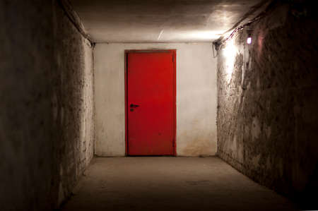 basement: Heavy red steel doors closed Stock Photo