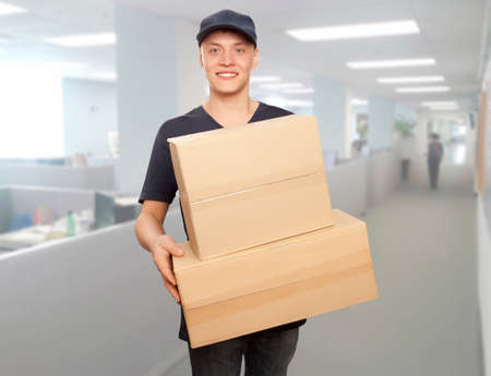warehouseman: Handsome young delivery man portrait