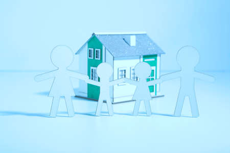 adopting: The paper family buys a home. Blue light