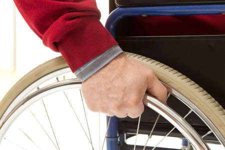 enforce: Wheelchair user makes various movements with his wheelchair, exercises for safety handling Stock Photo
