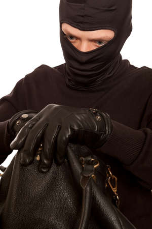stealing money: Thief stealing money from women handbag. Isolated on white background Stock Photo