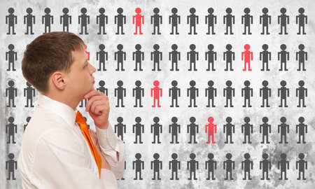layoffs: Businessman solves the problem of layoffs Stock Photo