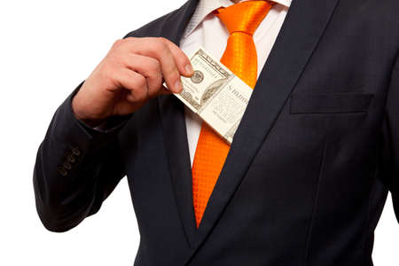 putting money in pocket: Businessman putting money in suit jacket pocket, concept for corruption, bribing