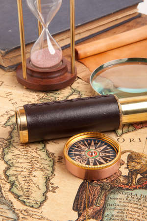 Vintage brass telescope on old antique map photo