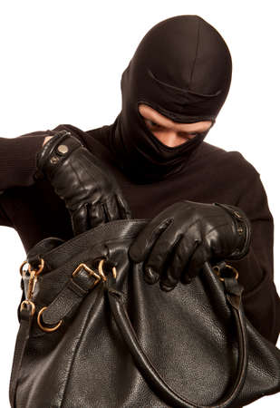 pickpocket: Thief stealing money from women handbag. Isolated on white background Stock Photo